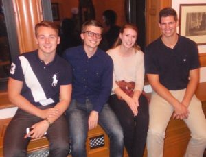 "From left to right, Zach Herman, Brandon McNeill, Jess Hefferon and Noah Davis all group together in the parlors to witness Davis's honors capstone project titled, ""Poetry of Place: Appalachian Literature and Bioregionalism."" Photo courtesy of N.Davis."