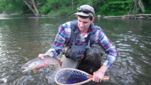 A favorite hobby of Davis's is fly fishing. Here he holds a brown trout that he caught in Little Juniata River in 2015. He dreams to one day reside either in Vermont, because the outdoor community is very rural and the scenery is beautiful, or Bellwood, Pa. simply because that is where home is and where he grew up all his life. Photo courtesy of N.Davis.