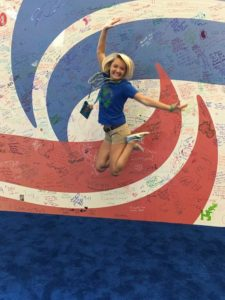 Grimm jumps for a photo after competing in her fourth Transplant Games of America, a multi-sport festival for transplant survivors. Photo courtesy of Colleen Grimm.
