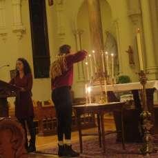 The sixth candle is lit. Photo by C.Arida/Setonian.