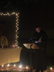 Father Pio prepares to bless the crib after all the figures have been placed.