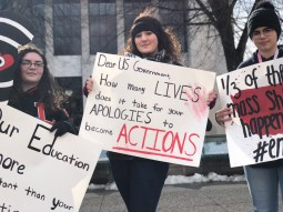 Students from Greater Latrobe Senior High School hold their signs during the March for Our Lives rally in Greensburg on March 23.