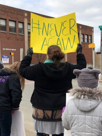 A demonstrator hoists her sign during the March for Our Lives rally in Greensburg on March 23.