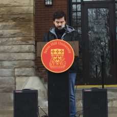 SHU freshman Mark Nealon speaks at beginning of SHU's walkout on March 14. Photo by L.Cowan/Setonian.
