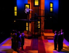 """Friends of Robert (Noah Telford) watch him on his balcony during Seton Hill University's production of """"Company"""" from Oct. 19-27."""