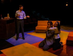 """Robert (Noah Telford) watches as married couple Harry (Lance Joos) and Sarah (Riley Tate) playfully fight with one another during Seton Hill University's production of """"Company"""" from Oct. 19-27."""