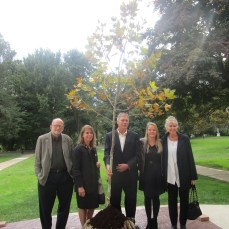Members of Suzanne Rogers' family pose for a photo with the tree dedicated to Rogers on Oct. 12. From left: Jim Borchard (brother-in-law), Kathy Dethier (sister), Vincent Dethier (brother), Suzie Borchard (niece) and Sheryl Dethier (sister-in-law).