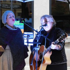 The duo Heavenly Biscuits performs as members of the community gather for the candlelight vigil at the Westmoreland County Courthouse in Greensburg on Oct. 29 for the victims of the shooting at the Tree of Life synagogue in Squirrel Hill.