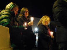 From left: Seton Hill University professors Jen Jones, Debra Faszer-McMahon and Christine Cusick hold candles at the vigil at the Westmoreland County Courthouse in Greensburg on Oct. 29 for the victims of the shooting at the Tree of Life synagogue in Squirrel Hill.