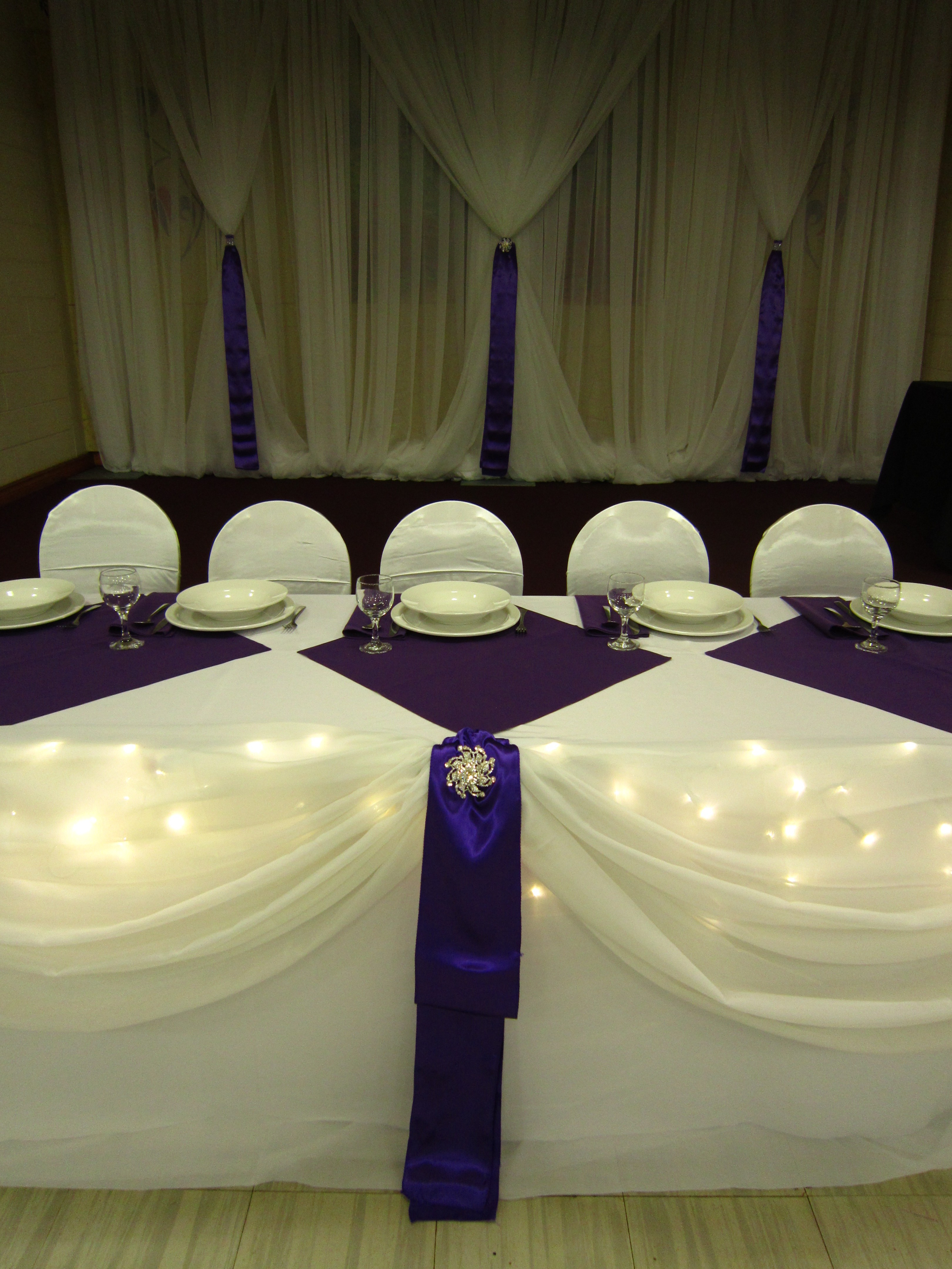 wedding chair covers toronto wrought iron feet head table with icicle lights   set the mood decor
