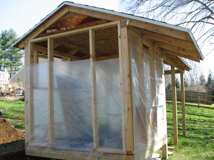 Extended roofline to accommodate a storage shed for chickens and beekeeping supplies