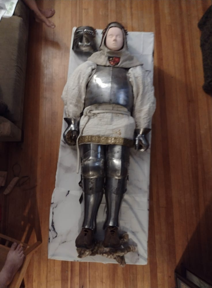 Dummy in reproduction armor as effigy