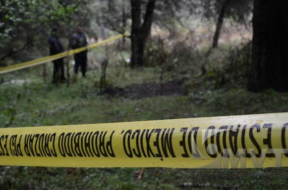 Hallan cuerpo de mujer quemado en Lerma