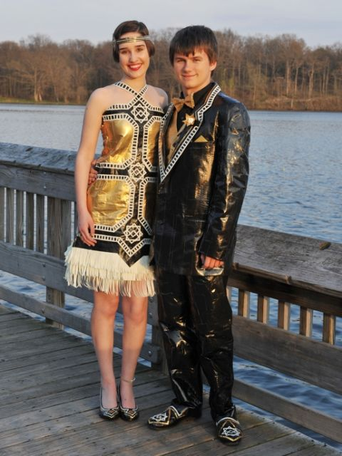 """Gabrielle and her date matched their duct-tape ensemble to their school's Great Gatsby prom theme. """"Our design's geometric symmetry is modeled after the era's Art Deco style, while the bold contrast of gold, black, and white reflect the extravagance of life in the Roaring '20s,"""" they told stuckatprom.com."""