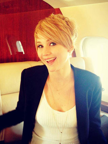 """After filming Catching Fire, J. Law debuted this amazing punk-y pixie during a Google+ Hangout with the cast! She explained her new 'do, saying, """"I just did it to make [Director] Francis [Lawrence] mad. I did it just to annoy him. He totally thought it was me giving him the finger. But it's not. It's just fried from being dyed so much."""" Whatever the reason, we love the look!"""