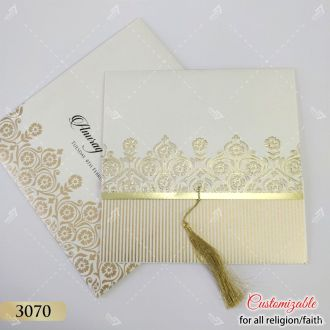 white and gold wedding card with golden tassle