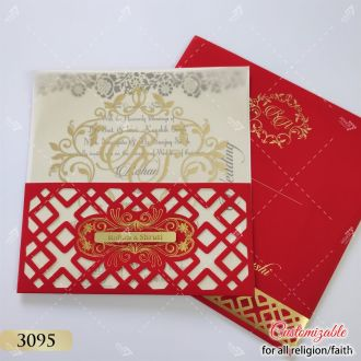 red jaali cutwork wedding card with tracing paper and cream inserts