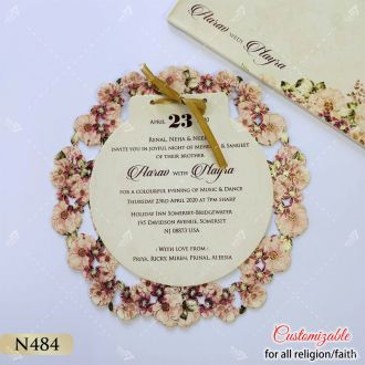 oval shape floral printed lasercut wedding invitation from Indian Designers