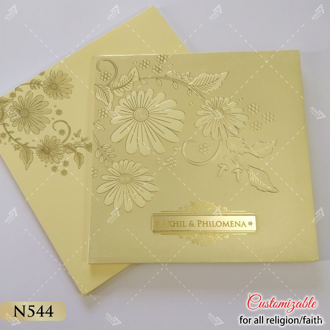 cream golden embossed designer wedding cards