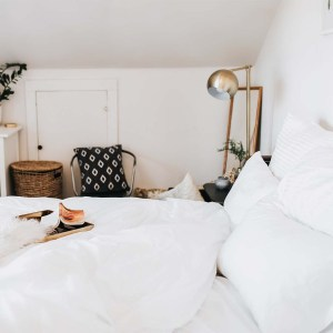 bedroom shot with comforter, pillows, pillowcases, and sheets