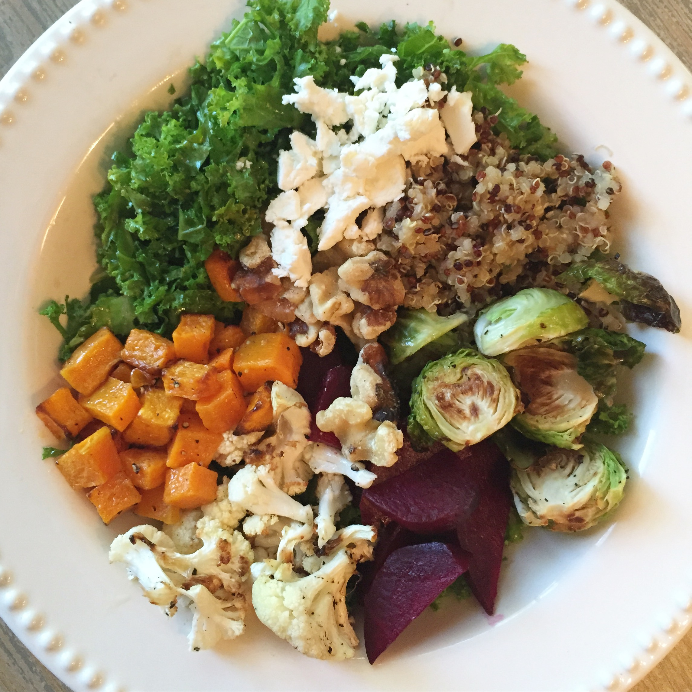 clean eating fall vegetable salad; kale, beets, brussels sprouts, cauliflower, sweet potato, goat cheese salad