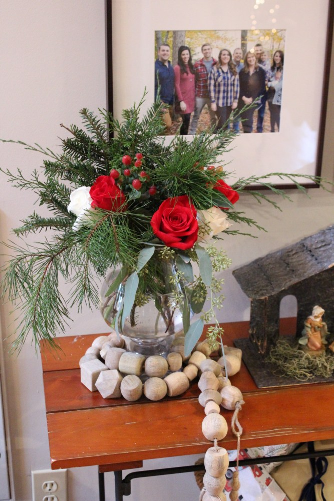 Christmas red and white flower arrangement; Christmas dinner party at home; rustic Christmas decor