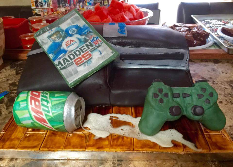 PlayStation 3 Cake with Mountain Dew Can, Game Controler and Madden 25 game.