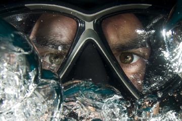 suba diver mask with bubbles underwater