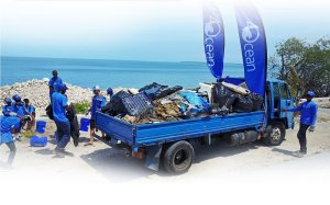 4ocean team by the sea at a beach cleanup removing marine litter