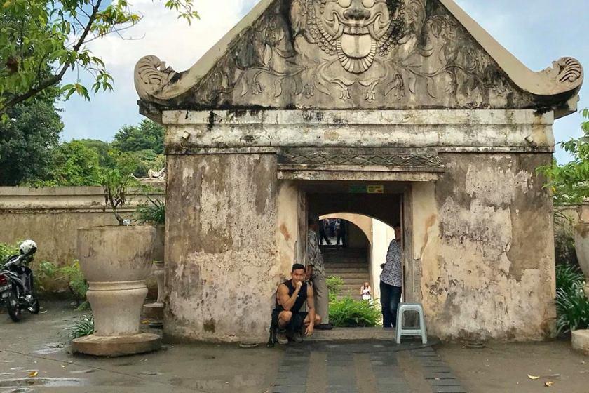 Em Surasak travel blogger for sevenseas media poses by some ruins in indonesia