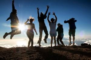 people jumping in maui by Maui Jeff Beige