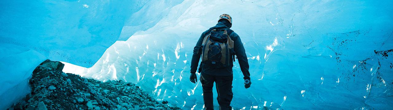 man hiking on a glacier