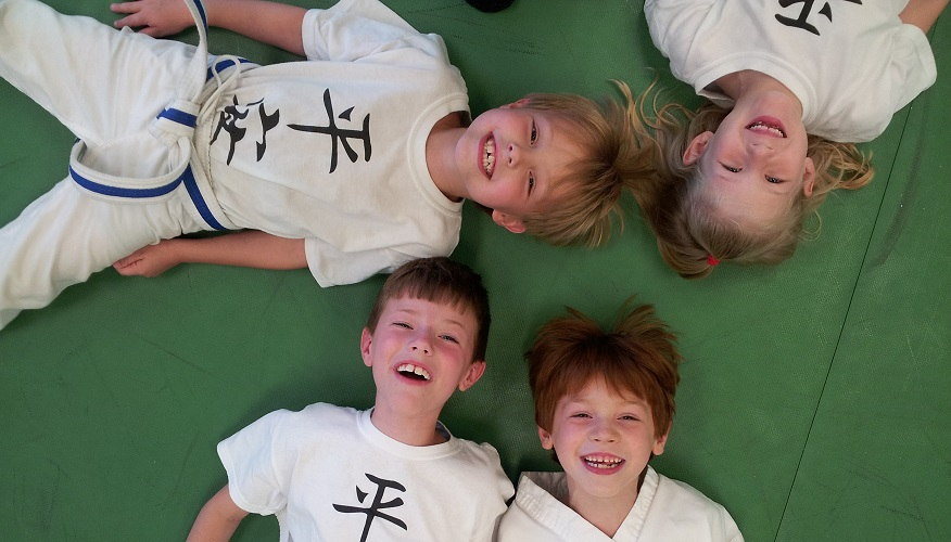 Our kids karate students show off their big smiles!