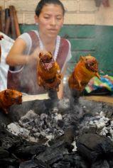 Roasting cuy, Gualacea, Ecuador