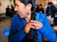 Doing the all-important plaits before a cholita fashion show, El Alto, La Paz.