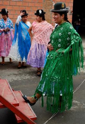 Getting ready to go on stage, cholita fashion show, El Alto, La Paz.