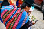 Many indigenous Bolivian women carry a cloth filled with goods on their back.