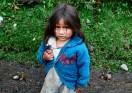 Little girl looking for sweets at the beginning of the Santa Cruz trek, Cordillera Blanca, Peru