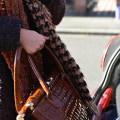 woman loading bag into car boot