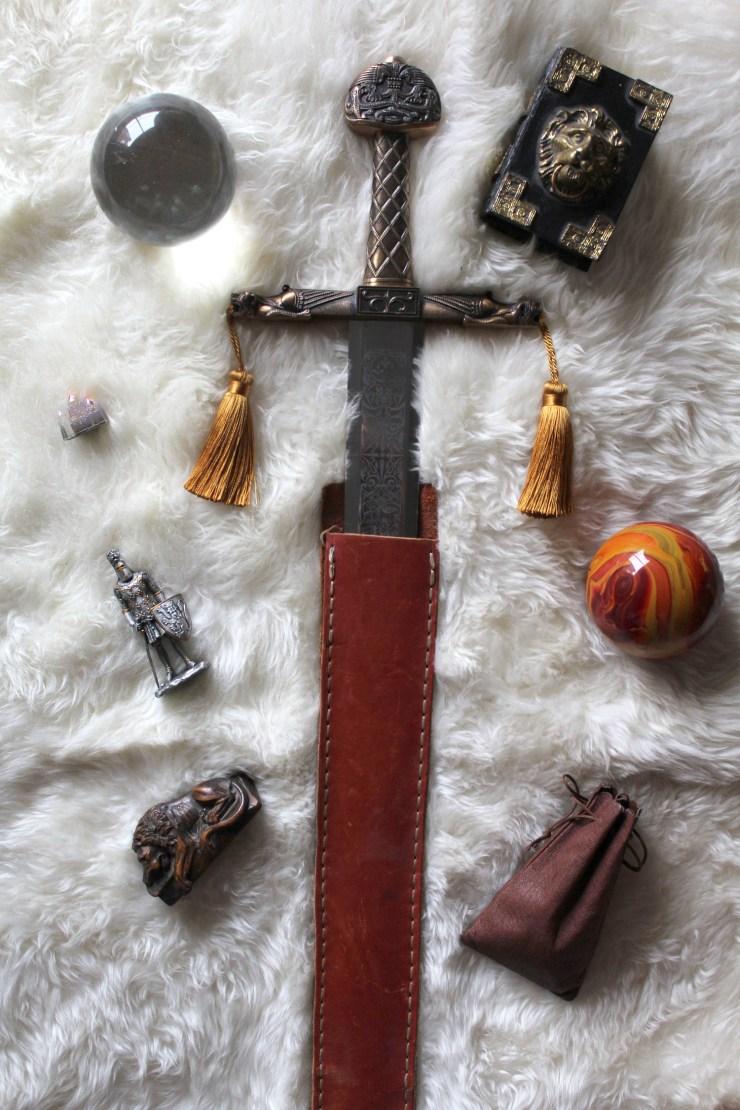 fantasy sword, globe, sphere, prop, lion, books