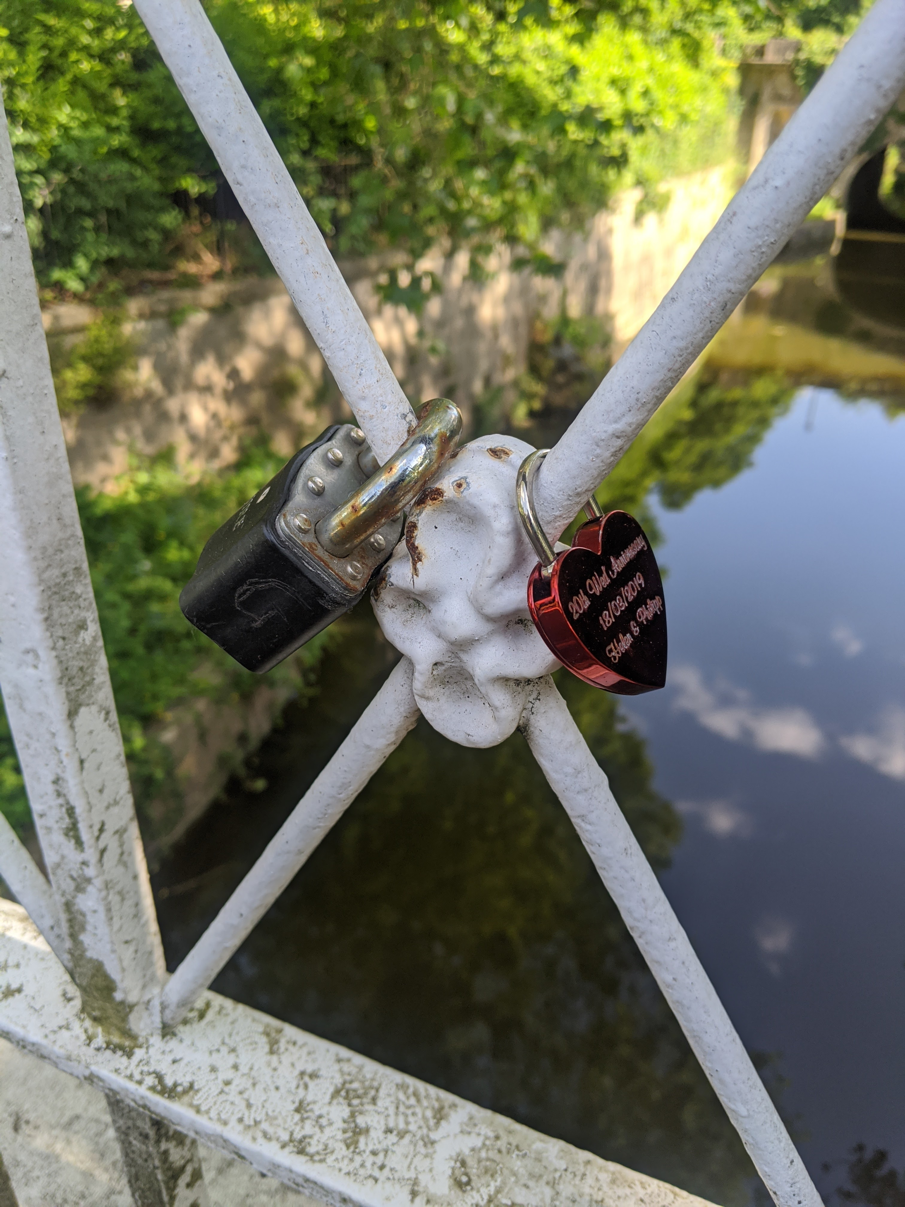 love token padlocks attached to Sydney Gardens bridge