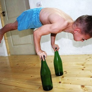 Giuliano Stroe performs a dangerous stunt that involves balancing on glass bottles.