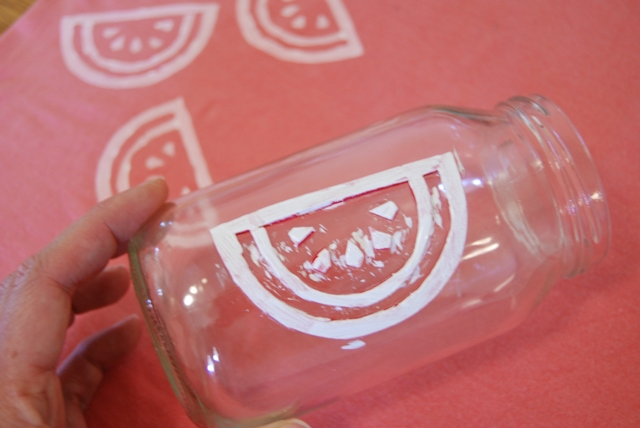 Paint laden watermelon fabric stamp