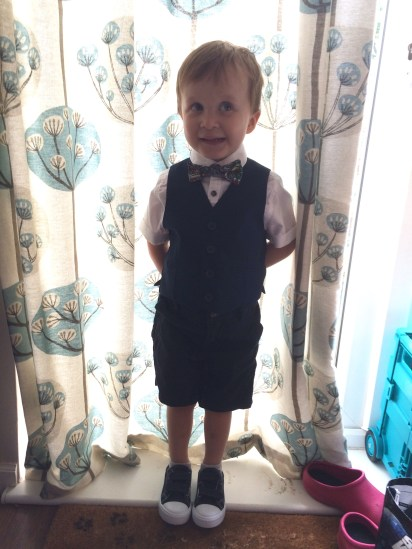 My son wearing his Legend of Zelda bow tie to the wedding of a family friend.
