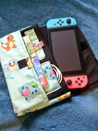 The Switch case has a fleece lined pocket for the console plus space for 3 carts, a cable/headphones and a boxed game.