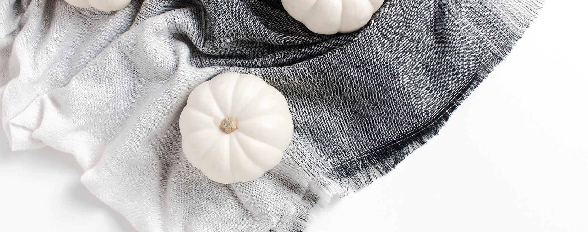 white pumpkins on a scarf