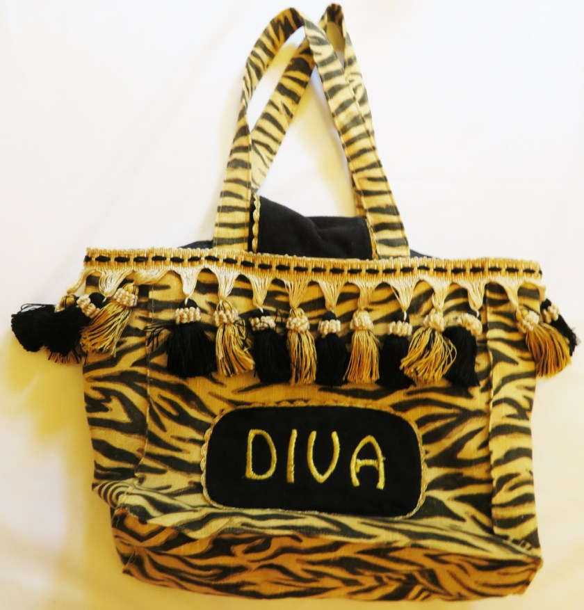 This image has an empty alt attribute; its file name is Diva-Pocketbook-by-LJ-Christensen-981x1024.jpg