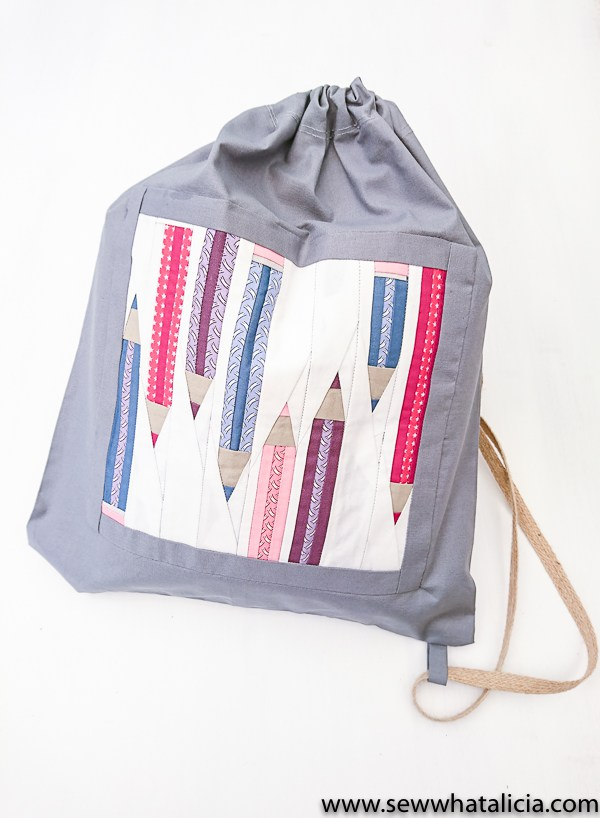 Tutorial and pattern: Drawstring backpack with a paper pieced pencil design