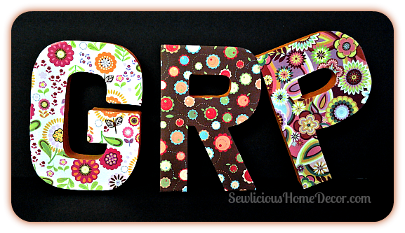 Scrapbook paper covered letters