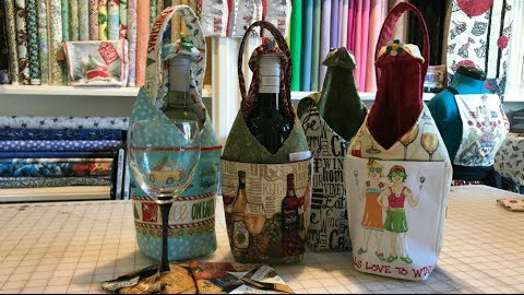 FREE Wine Bottle Bag Video Tutorial. Watch this awesome video tutorial and create your own beautiful gift or for you to use in a holiday season.